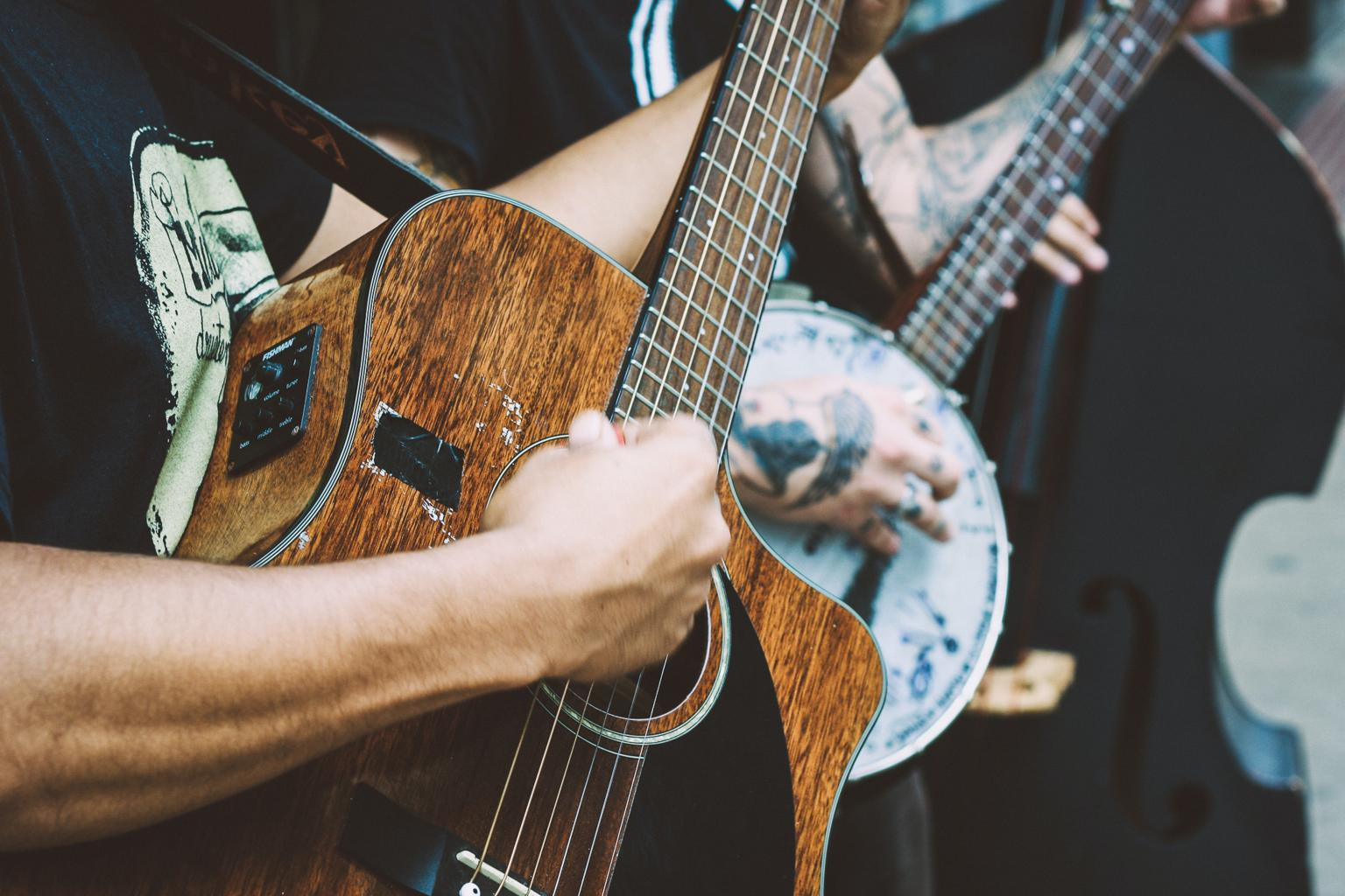 Close-up view of a guitar and banjo